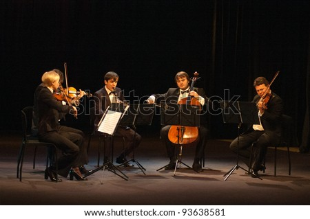 DNEPROPETROVSK, UKRAINE - DECEMBER 19: Members of the QUINTA Orchestra performed music of  Williams on December 19, 2011 in Dnepropetrovsk, Ukraine - stock photo