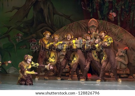 "DNEPROPETROVSK, UKRAINE - FEBRUARY 18: Unidentified children, ages 7-15 years old, perform musical spectacle ""Mowgli"" on February 18, 2013 in Dnepropetrovsk, Ukraine"