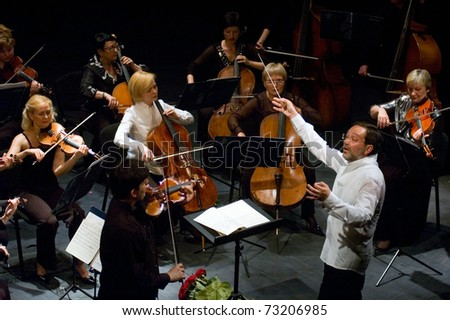 DNEPROPETROVSK, UKRAINE-JUNE 15: 'Four seasons' Chamber Orchestra - main conductor Dmitry Logvin performed music of Elgar, Bruch, Tchaikovsky on June15,2009 in Dnepropetrovsk, Ukraine - stock photo