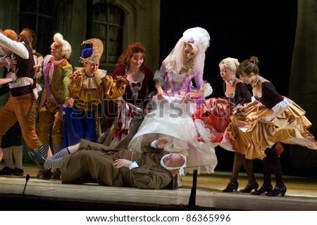"DNEPROPETROVSK, UKRAINE - JUNE 25: Members of the Dnepropetrovsk State Opera and Ballet Theatre perform "" The Barber of Seville"" on June 25, 2011 in Dnepropetrovsk, Ukraine"