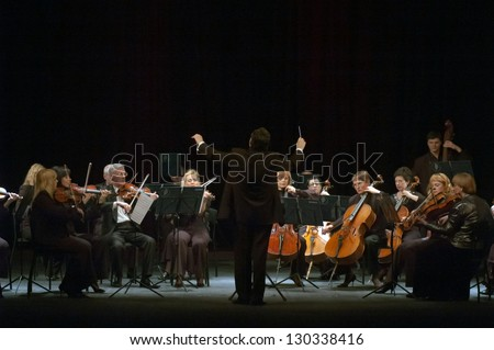 """DNEPROPETROVSK, UKRAINE - MARCH 4: """"Four seasons"""" Chamber Orchestra - main conductor Dmitry Logvin perform music of  Mendelssohn on March 4, 2013 in Dnepropetrovsk, Ukraine - stock photo"""