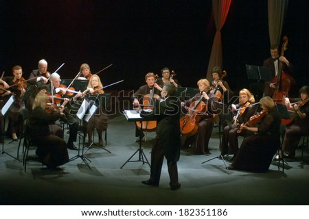 DNEPROPETROVSK, UKRAINE - MARCH 17: FOUR SEASONS Chamber Orchestra - main conductor Sergey Burko perform at the State Russian Drama Theatre on March 17, 2014 in Dnepropetrovsk, Ukraine