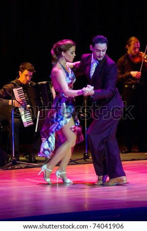 DNEPROPETROVSK, UKRAINE - MARCH 26: The dancers Gimena Aramburu and Juan Fossati (Argentina) at Stars of Argentine Tango show on March 26, 2011 in Dnepropetrovsk, Ukraine.