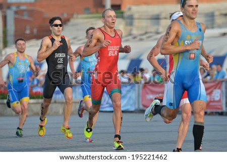 DNEPROPETROVSK, UKRAINE - MAY 24, 2014: Aliaksandr Vasilevich of Belarus and other athletes run on the third stage of ETU Sprint Triathlon European cup