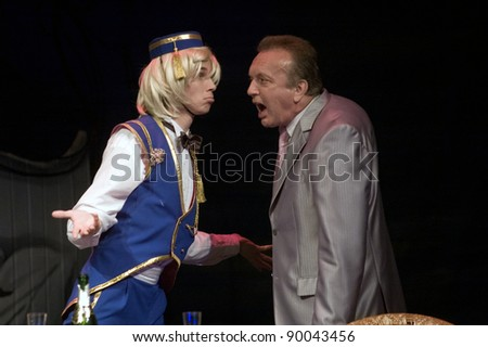 "DNEPROPETROVSK, UKRAINE - MAY 14: Members of the Dnepropetrovsk State Russian Drama Theatre perform "" Women's mind and man's naivety"" on May 14, 2010 in Dnepropetrovsk, Ukraine"