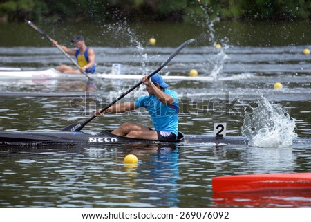 DNEPROPETROVSK, UKRAINE - MAY 29, 2013: Unidentified paddlers in kayak racing during Ukrainian paddling championships. Dnepropetrovsk rowing canal is the main Ukrainian sport arena in kayaking - stock photo
