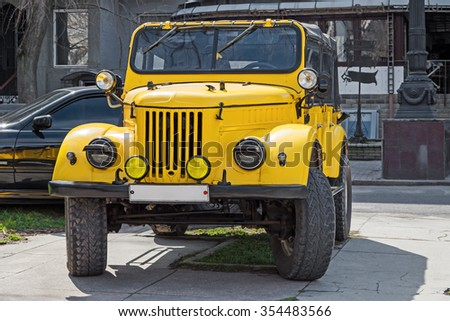 Dnepropetrovsk, Ukraine - October 30, 2013: Exhibition of cars and motorcycle other vintage technics - stock photo