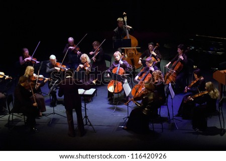 DNEPROPETROVSK, UKRAINE - OCTOBER 22: Four seasons Chamber Orchestra - main conductor Dmitry Logvin perform music of George Frideric Handel on October 22, 2012 in Dnepropetrovsk, Ukraine - stock photo