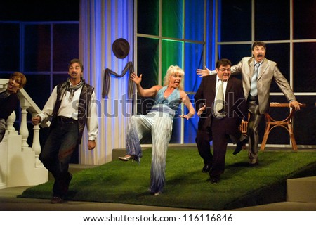 "DNEPROPETROVSK, UKRAINE - OCTOBER 19: Members of the Dnepropetrovsk State Russian Drama Theatre perform ""The piano on the grass"" on October 19, 2012 in Dnepropetrovsk, Ukraine"