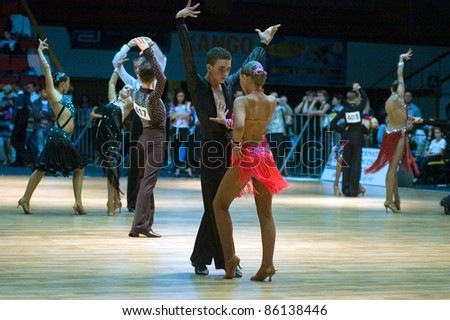 DNEPROPETROVSK, UKRAINE - SEPTEMBER 24: An unidentified dance couple in a dance pose during World Dance Competition DNEPR CUP 2011 on September 24, 2011 in Dnepropetrovsk, Ukraine.