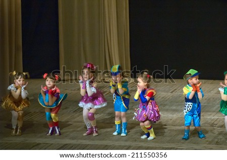 DNIPROPETROVSK, UKRAINE - APRIL 12: Unidentified children, ages 4-9 years old, perform MEDITATION at the State Palace of children and youth on April 12, 2014 in Dnipropetrovsk, Ukraine - stock photo