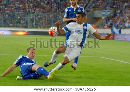 DNIPROPETROVSK, UKRAINE - AUGUST 9, 2015: Leo Matos FC Dnipro (R) fights for the ball with Oleg Gusev FC Dynamo(L) during Ukrainian Championship game. - stock photo