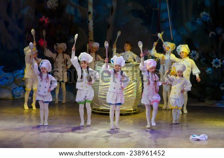 DNIPROPETROVSK, UKRAINE - DECEMBER 19: Unidentified children, ages 7-10 years old, perform COOKS at the State Palace of children and youth on December 19, 2014 in Dnipropetrovsk, Ukraine - stock photo