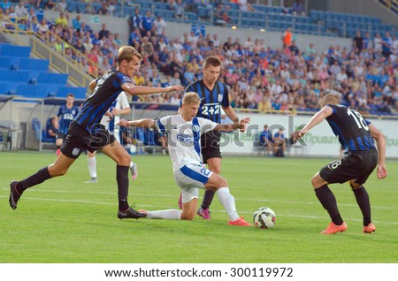 DNIPROPETROVSK, UKRAINE - JULY 26, 2015: Valery Fedorchuk FC Dnipro (C) fights for the ball with three players of FC Chernomorets during Ukrainian Championship game. - stock photo