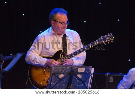 DNIPROPETROVSK, UKRAINE - JUNE 5: Famous guitarist Victor Kovalenko and members of the Philharmonic Society Jazz Orchestra perform on June 5, 2015 in Dnipropetrovsk, Ukraine - stock photo