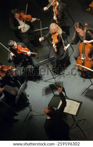 DNIPROPETROVSK, UKRAINE - MARCH 9: FOUR SEASONS Chamber Orchestra - main conductor Dmitry Logvin perform at the State Russian Drama Theatre on March 9, 2015 in Dnipropetrovsk, Ukraine - stock photo