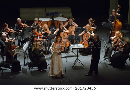 DNIPROPETROVSK, UKRAINE - MAY 26: Singer Nadezhda Eremenko and FOUR SEASONS Chamber Orchestra  - conductor Sergey Burko perform on May 26, 2015 in Dnipropetrovsk, Ukraine - stock photo