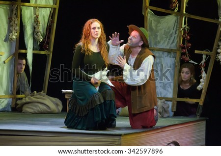 DNIPROPETROVSK, UKRAINE - NOVEMBER 21, 2015: Nadezhda Petrenko and Vladimir Kosonog perform DULCINEA TOBOSSKAYA  at the Dnipropetrovsk Youth Theatre VERIM. - stock photo