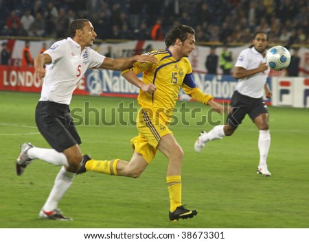 DNIPROPETROVSK, UKRAINE - OCT 10: Rio Ferdinand (L) of England fights for a ball with Artem Milevskyi (C) of Ukraine during the FIFA WC2010 qualifying football match on Oct 10, 2009 in Dnipropetrovsk