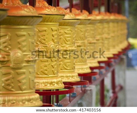 Do drul chorten at buddha park, this is the holy cylinder people use to roll in order to pray for god. - stock photo