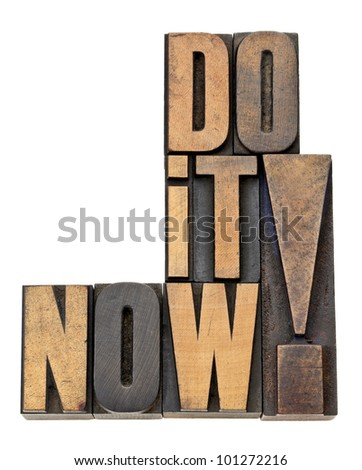 do it now - motivation and encouragement - isolated phrase in vintage letterpress wood type - stock photo