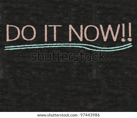 do it now written on blackboard background