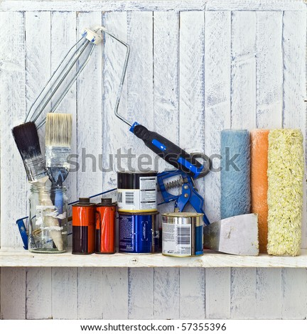 Do it Yourself (DIY) and decorating tools on workshop shelf --  good copy space on white-painted wall - stock photo