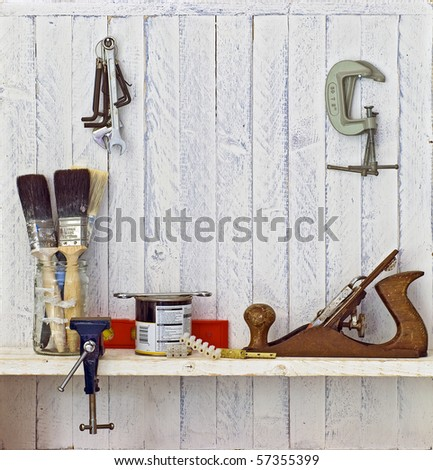 Do it Yourself (DIY) tools on workshop shelf --  good copy space on white-painted wall - stock photo