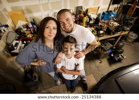 Do-it-yourself family in their garage. - stock photo