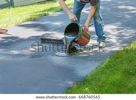 Do yourself home maintenance driveway resealing stock photo image do it yourself home maintenance driveway resealing repair homeowner pours blacktop sealant onto driveway solutioingenieria Images