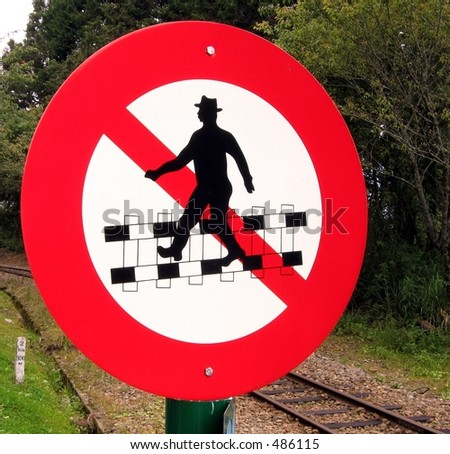 Do Not Cross Railroad Tracks! -- unusual traffic sign - stock photo