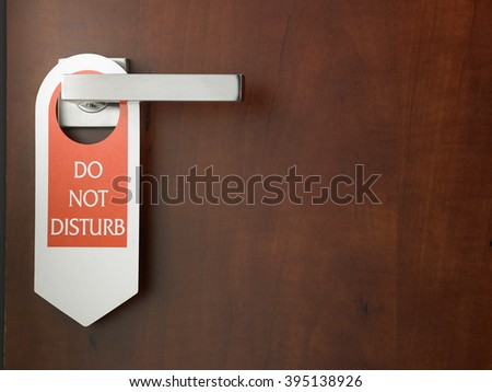 do not disturb door sign hanging at door handle - stock photo