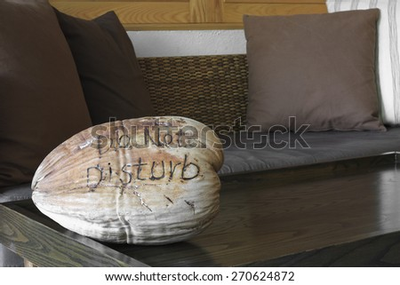 do not disturb on dry coconut in the hotel room - stock photo