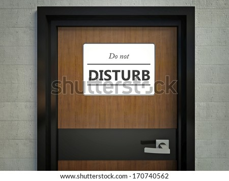 Do not disturb sign hanging on office door - stock photo