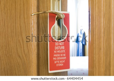 Do Not Disturb sign on a hotel room door - stock photo
