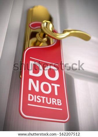 Do not disturb sign on hotel door handle - stock photo
