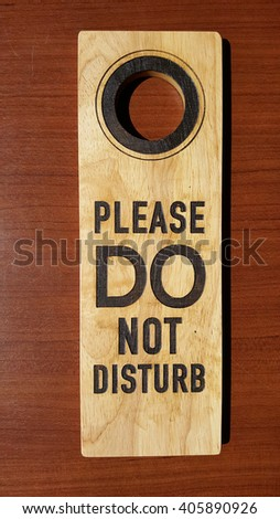 Do not disturb wooden on wooden table - stock photo