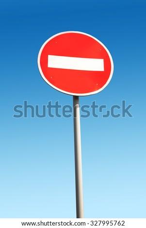 Do not enter traffic sign over blue sky - stock photo