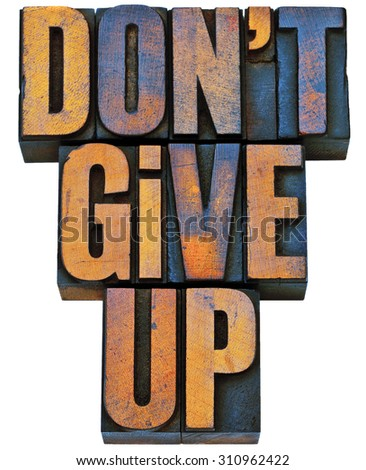 do not give up - motivation concept - isolated phrase in vintage letterpress wood type printing blocks stained by color inks - stock photo