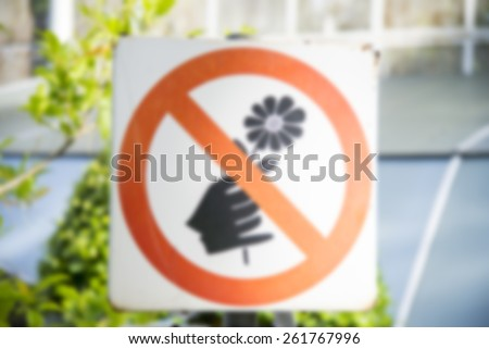 Do not pick the flowers sign in blur style - stock photo