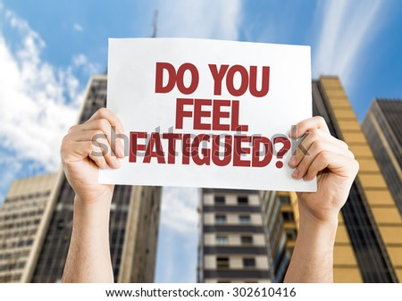 Do You Feel Fatigued? card with cityscape background - stock photo