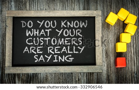 Do You Know What Your Customers Are Really Saying? written on chalkboard - stock photo