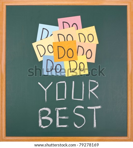 Do your best, paper cards and words on blackboard. - stock photo