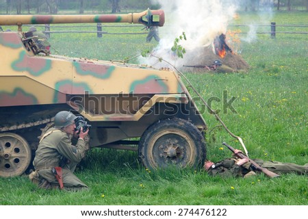 DOBRANY, CZECH REPUBLIC - MAY 1, 2015: American war reporter in battlefield. Liberation festival to 70th Anniversary of the Liberation by the US Army and the End of the Second World War in Europe. - stock photo