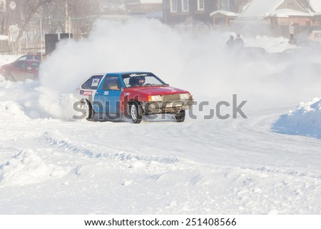 Dobryanka, Russia - February 7, 2015. Urban ice race. Blue red VAZ-2114 racing on snow race track in winter - stock photo
