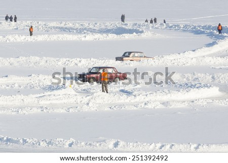 Dobryanka, Russia - February 7, 2015. Urban ice race. Machines on the track top view