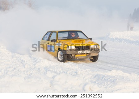 Dobryanka, Russia - February 7, 2015. Urban ice race. Yellow VAZ-2114 on winter road - stock photo