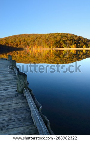 Dock at Mountain Lake in Autumn - stock photo