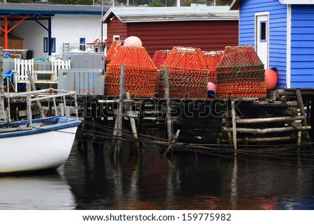 Dock for crab fishermen with stocked on pile Crab Nets in Petty Harbor, Newfoundland, Canada.  - stock photo