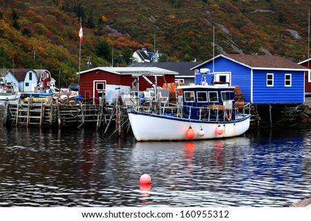 Dock for crab fishing boats, stocked on pile Crab Nets, bungalows for equipment in Petty Harbor, Newfoundland, Canada in fall season.  - stock photo